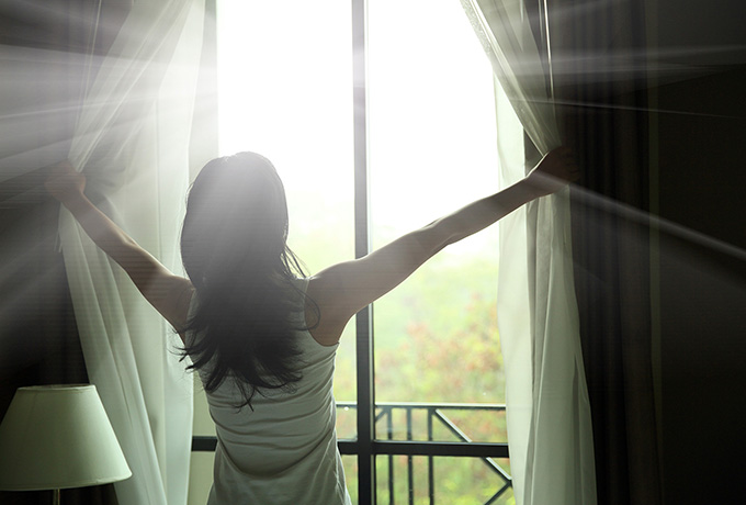 Women waking up to an early sunrise forming a new habit
