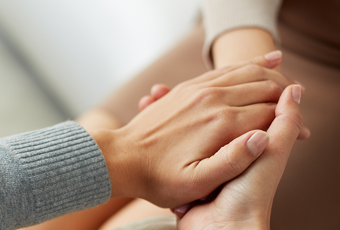 Close up of people holding hands