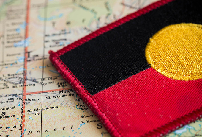 Aboriginal flag placed atop a map of Australia
