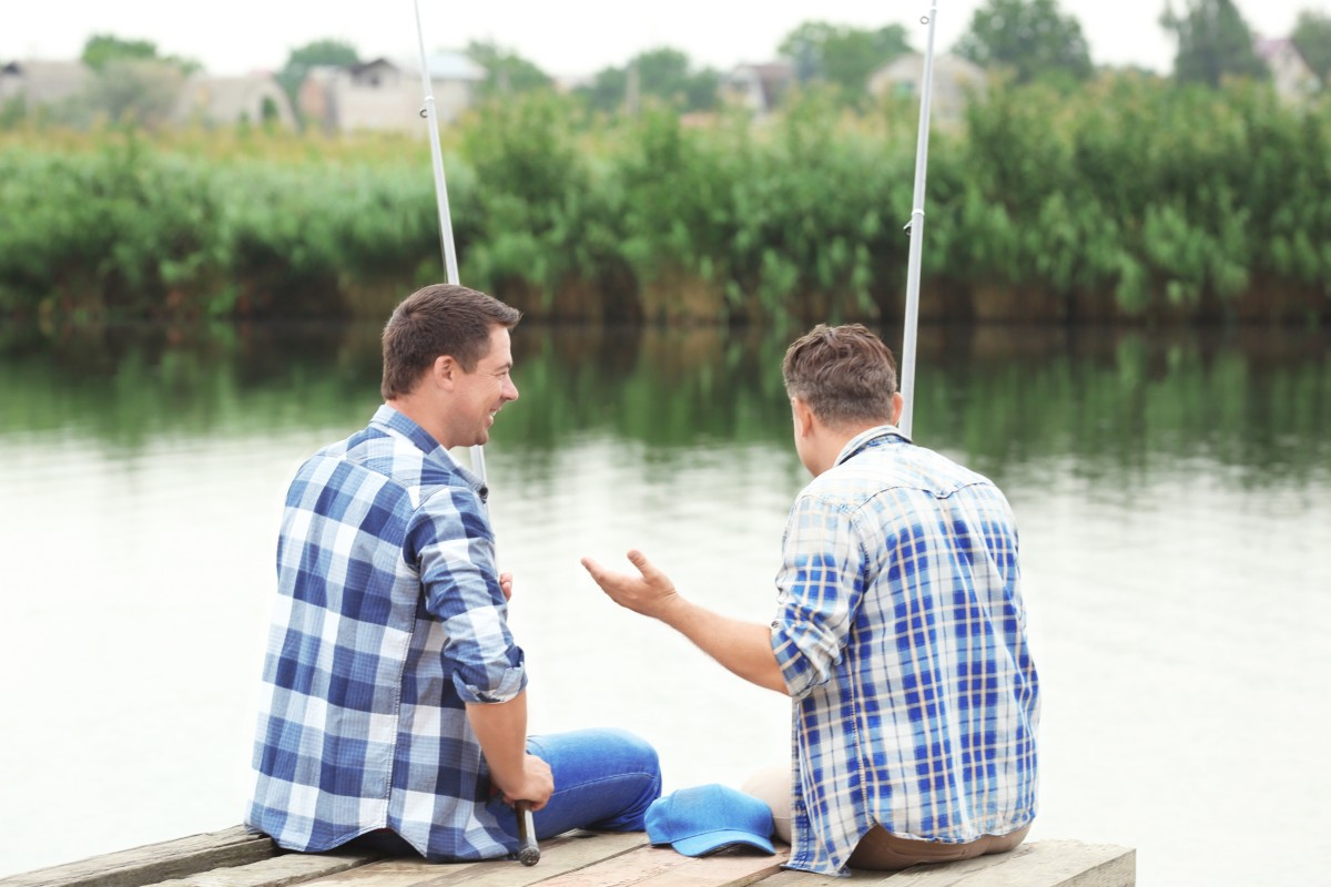 two men fishing & chatting - activity based approaches to men's mental health are part of the change we need