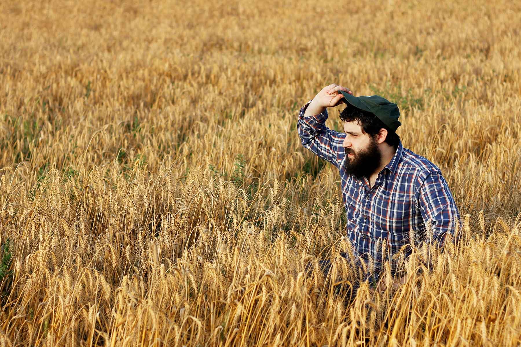 Man standing in a field in rural Australia farm