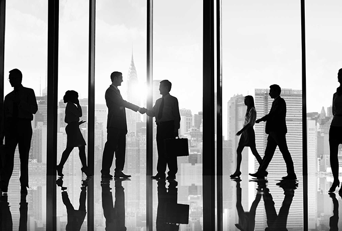 Group of business people meeting and shaking hands