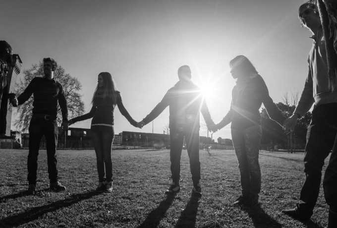 Group of people supporting one another